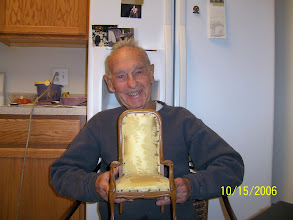 Photo: Dad and the chair.  Dad found the chair in an abandoned barn in Belgium and it was reupholstered with a piece of fabric from my parents' new living room furniture circa 1968.