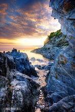Photo: Through The Gap. Combsegate Beach in North Devon, a place to got lose yourself, so many nooks and crannies to explore, even more beautiful as the sun sets.
