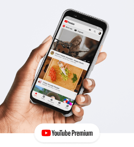 A hand holds a phone that shows the YouTube Premium interface