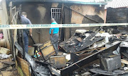 A mother and her two daughters have burnt to death in a fire Credit: Supplied by SAPS