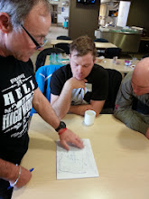 Photo: The game plan -Barney goes over some race strategy - lots to consider with he tide, flow, ice, water and wind