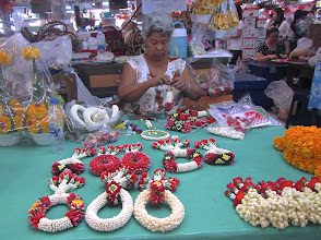 Photo: This woman makes beautiful fresh flower garlands at Or Tor Kor.