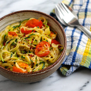 Warm Zucchini Noodles With Tomatoes And Halloumi.