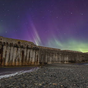 Northern lights over the shipwreck by Grete Øiamo - Landscapes Waterscapes ( water, shipwreck, waterscape, ship, green, northern lights, aurora borealis, trondheim, beach, stones, fjord, norway )
