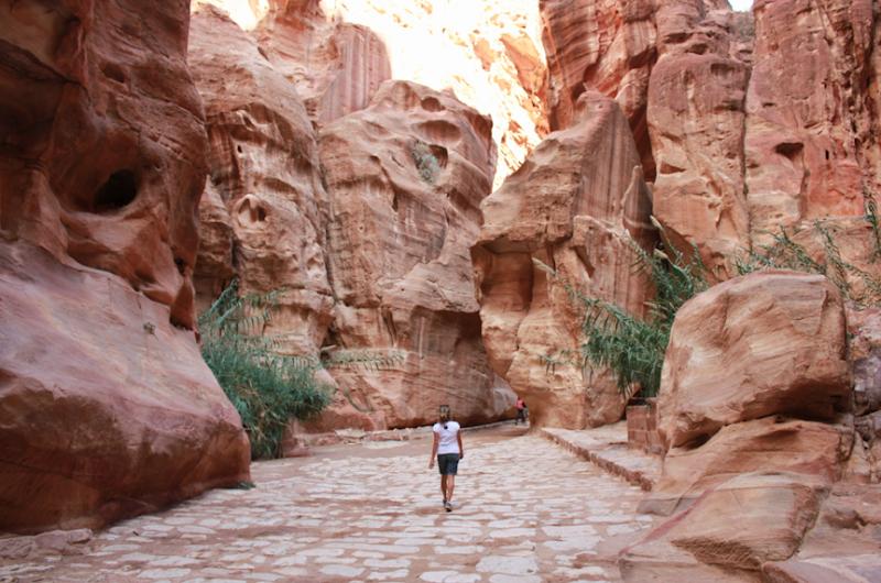 Passing through Al Siq, the narrow canyon that leads to the entrance of Petra, Jordan.