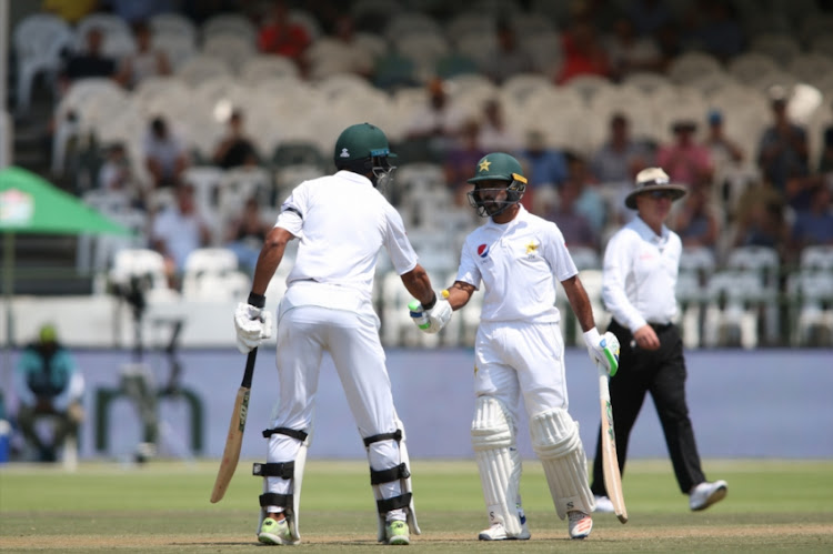 Shan Masood of Pakistan and Asad Shafiq of Pakistan celebrate their 100 partnership during day 3 of the 2nd Castle Lager Test match between South Africa and Pakistan at PPC Newlands on January 05, 2019 in Cape Town, South Africa.