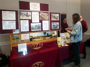 Photo: 022 This very impressive 7mm NG Association publicity stand incorporates a small layout, which we will see more of later, and the Association publications, which are ably controlled by Richard Jones .