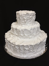 Photo: Rustic wedding cake: rough, hand iced  in white whipped cream frosting.