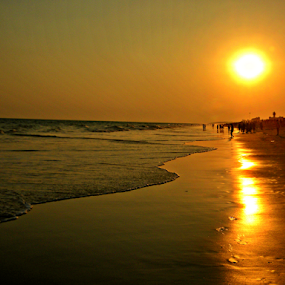 Sunset at sea beach by Saptak Banerjee - Landscapes Sunsets & Sunrises ( water, nature, sunset, sea, yellow, beach, sun )