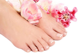 a ladies feet lying in flowers