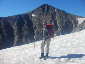 Photo: Steph on a snowfield with Hallett Peak rising above. Photo courtesy of Steph Petri