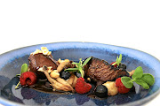 One of Embarc's fine-dining dishes: medallions of ostrich fillet with exotic mushrooms and seasonal berries.