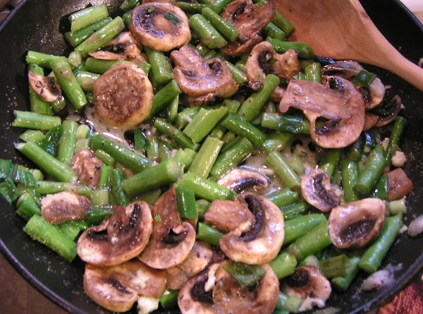 Reduce heat to a meduim/low and add mushrooms, onions, and garlic; cover and heat...