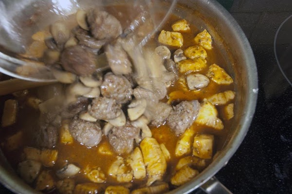 When the sherry is almost evaporated, add the broth, Worcestershire, and the reserved mushroom/sausage...