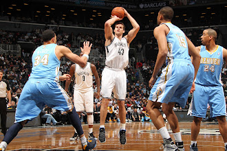 Photo: Kris Humphries #43 of the Brooklyn Nets attempts a shot against the Denver Nuggets at the Barclays Center on February 13, 2013 inBrooklyn, NY.
