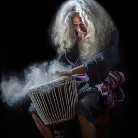 Jimbe Man by Indrawaty Arifin - People Portraits of Men ( sit, play, jimbe, man,  )