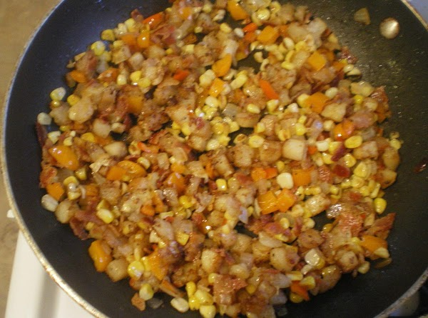 Add onion, peppers, garlic, and corn.  Cook stir until onions are translucent. ...