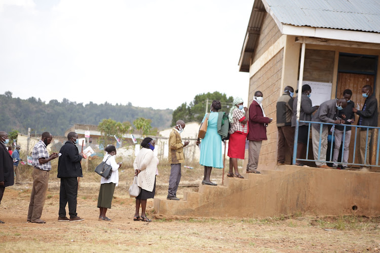 Baringo teachers line up to vote during the KNUT branch elections at Visa Oshwal primary in Kabarnet town, Baringo Central on Saturday.