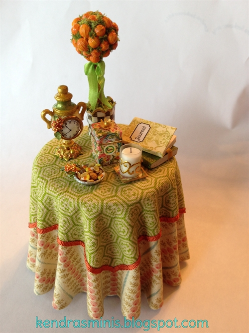 Photo: Fall theme table with pumpkin topiary