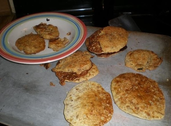 Now spoon fritter batter into the skillet according to the size fritters that you...