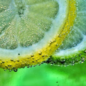 Lemon & Lime by Brian Wilson - Food & Drink Fruits & Vegetables ( water, refreshing, green, drink, juice, thirsty, glass, lime, yellow, lemon )