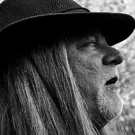 Burly Bryan by Barbara Brock - People Portraits of Men ( man with long hair, black and white, profile portrait, street portrait, man's profile )