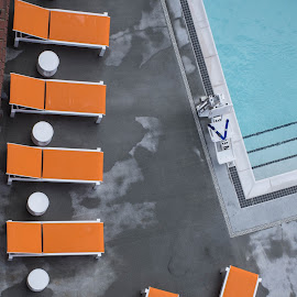 Chairs by Thomas Shaw - Buildings & Architecture Other Exteriors ( water, orange, chairs, white, raleigh, concrete, north carolina, tables, pool, blue, lounge, wet, hotel )