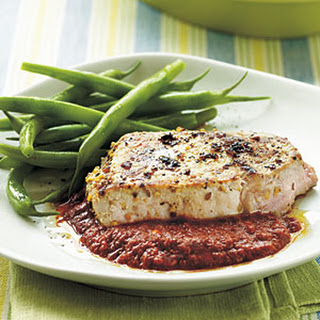 Seared Pork Chops with Spicy Roasted Pepper Sauce.