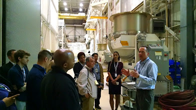 Photo: Ed Packard, Associate Head for the Environmental Test Engineering and Integration Branch, discusses tests done to make sure spacecraft can withstand the stress of launch.