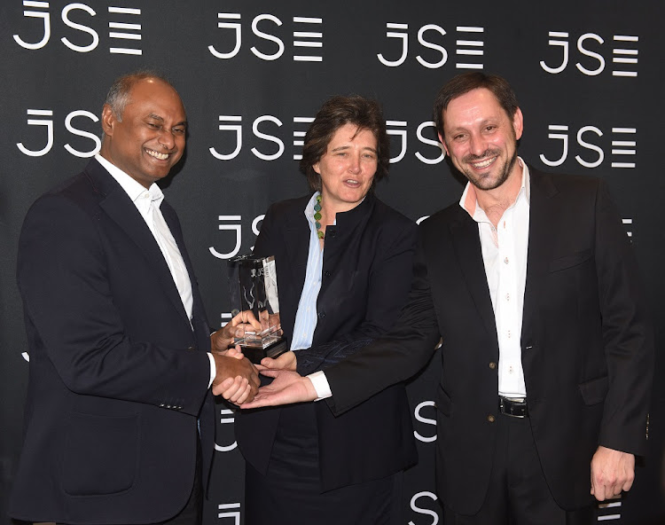 A good day: Steinhoff Africa Retail chairman Jayendra Naidoo, left, JSE CEO Nicky Newton-King and Steinhoff Africa Retail CEO Ben La Grange at the JSE in Sandton on Wednesday. Picture: FREDDY MAVUNDA