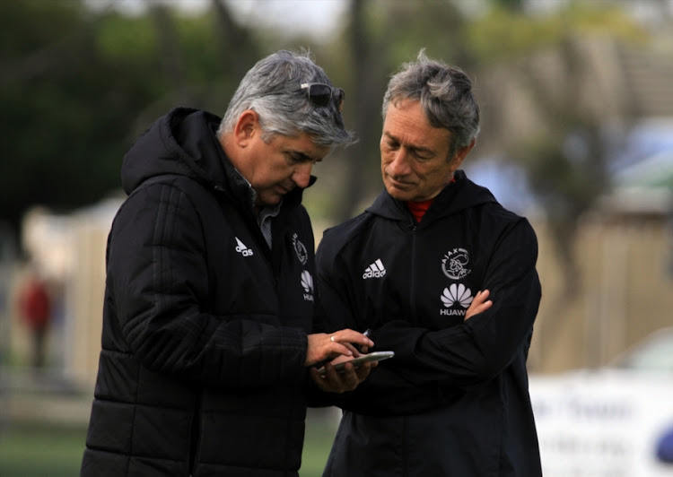 Ajax Cape Town CEO Ari Efstathiou (L) chats to head caoch Mushin Ertugral (R) during the club's training session and press conference at Ikamva on May 09, 2018 in Cape Town, South Africa.