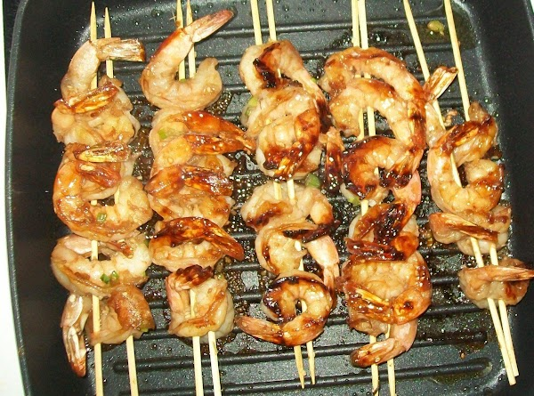 When you are ready to grille the shrimp, take two skewers at a time...