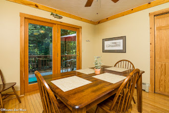 Photo: Rainbow Kitchen Table and Deck overlooking the River