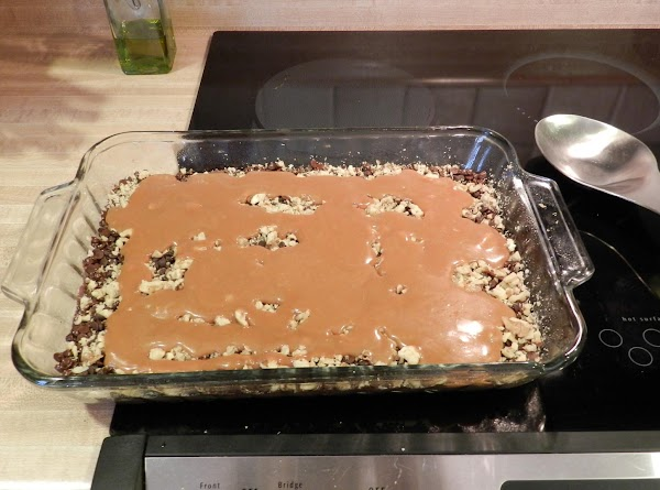 Sprinkle the chocolate chips, 1 cup of nuts over the crust you just baked....
