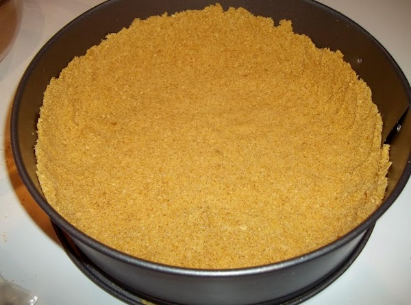 In a small bowl, combine cracker crumbs, butter and sugar. Set aside 1/4 cup...