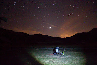 Photo: Amateur astronomer watching the night sky. Notice the meteorite and venus shining bright.