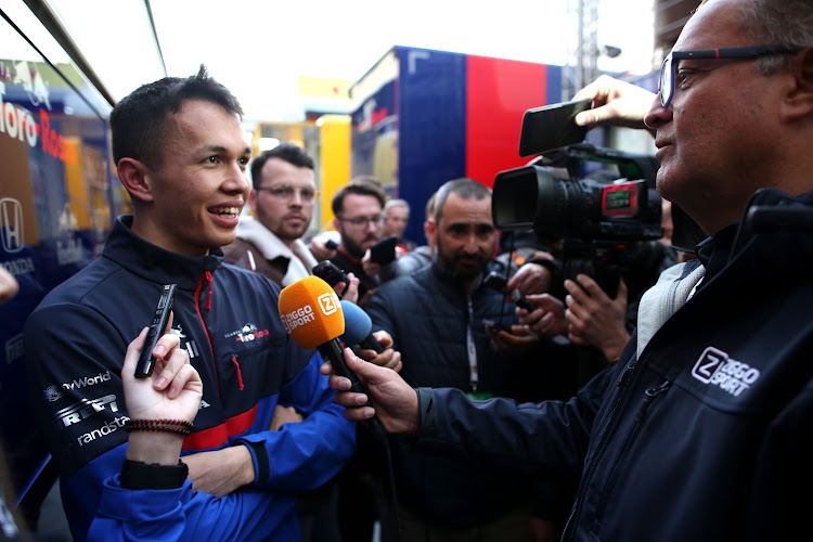 Alexander Albon of Thailand and Scuderia Toro Rosso talks to the media in the Paddock during F1 Winter Testing at Circuit de Catalunya on February 19, 2019 in Montmelo, Spain.