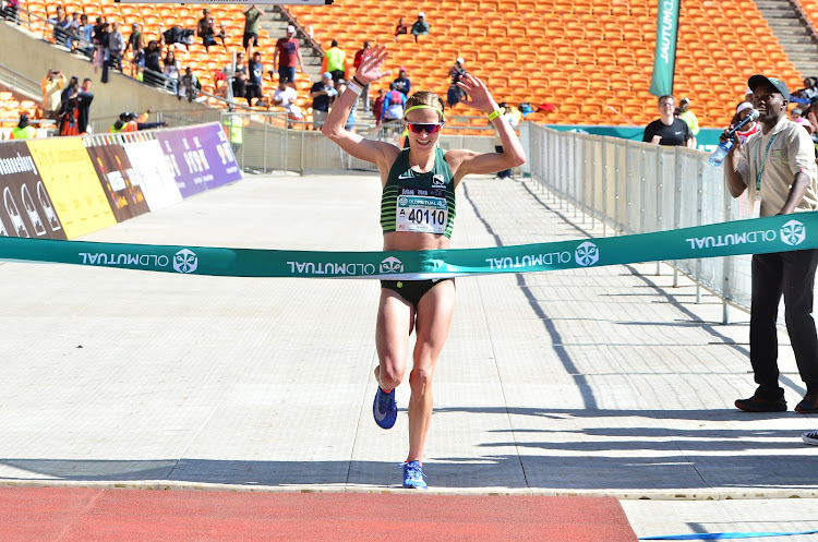 Middle distance champion Irvette van Zyl crosses the finish line first to win the 2018 Old Mutual Soweto Marathon on Sunday November 4, 2018 at FNB Stadium in Soweto, south west of Johannesburg.