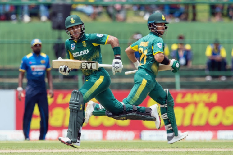 Reeza Hendricks (L) and JP Duminy (R) of South Africa running between wickets during the 3rd ODI between Sri Lanka and South Africa at Pallekele International Cricket Stadium on August 05, 2018 in Pallekele, Sri Lanka.