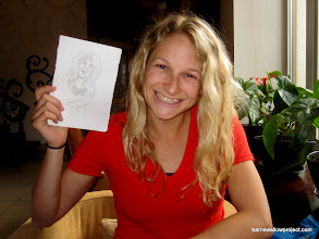 Photo: Liz poses with her portrait