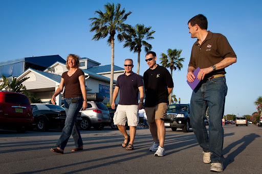 NASA astronauts from left Sandy Magnus Doug Hurley Chris Ferguson and Rex Walheim walk to dinner in Florida.