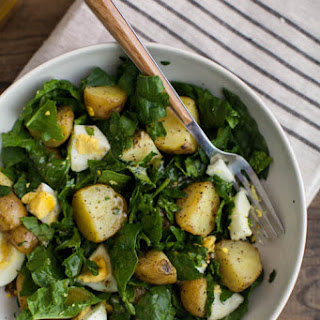 Garlic Roasted Potato, Egg, and Spinach Salad.