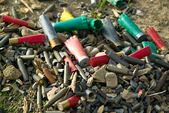 Photo: The area where we parked was littered with spent ammunition casings of all types and colors. I got a few together and took this picture.