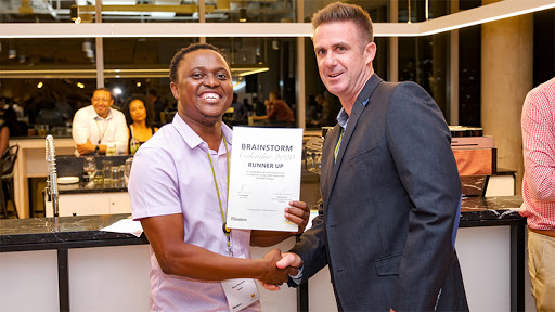 Runner-up Percy Maimela recieving his award from Mark Jackman, Huawei business unit executive at  iOCO. (Photo: PaulMcGavin). (Photo: PaulMcGavin)