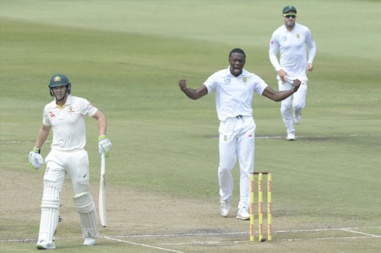 Kagiso Rabada of the Proteas celebrates the wicket of Tim Paine of Australia during day 2 of the 1st Sunfoil Test match between South Africa and Australia at Sahara Stadium Kingsmead on March 02, 2018 in Durban.