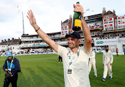 England's James Anderson celebrates after the fifth and final Test match against India at The Kia Oval in London on September 11, 2018. England won the series 4-1.