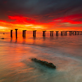 Old Pier by Rikkiboi Arim - Landscapes Waterscapes ( old pier, red sky, sea scapes, sunset, pylons )