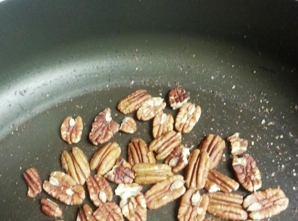 Toast walnuts by putting them in a skillet on medium heat for 3-4 minutes,...