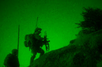 Photo: KUNAR PROVINCE, Afghanistan – Scaling treacherous terrain in the dead of night, Afghan National Army soldiers and troops assigned to Company B, 1st Battalion, 327th Infantry Regiment, Task Force Bulldog, use the cover of night to move into suspicious villages on a mountainside in the Pech River Valley in eastern Afghanistan's Kunar Province Nov. 23. (Photo by U.S. Army Staff Sgt. Mark Burrell, Task Force Bastogne Public Affairs)