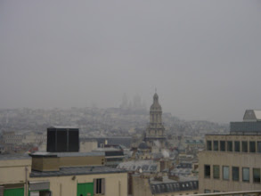 Photo: Now on the roof garden of Printemps, and another gray day, with Sacre Coeur barely visible in the distance.